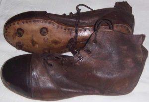 Chaussures de rugby avec crampons en cuir